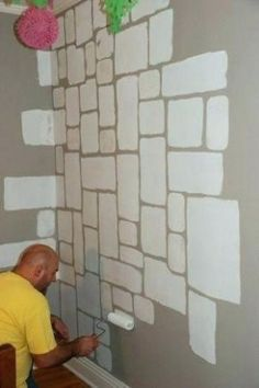 a castel stone wall., Painting the stones onto the wall with a sponge and a roller., Holding on to this for a future Harry Potter room Castle Rooms, Castle Bedroom, Bedroom Wall, Castle Wall, Bedroom Paint Design, Wall Design, Harry Potter Nursery, Cardboard Castle, Tadelakt