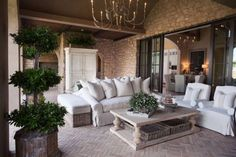 This cozy outdoor seating area features accessories from Paisley House. #PaisleyHouse #luxeHouston