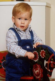 Prince Harry plays on his rocking horse at Kensington Palace in October 1985