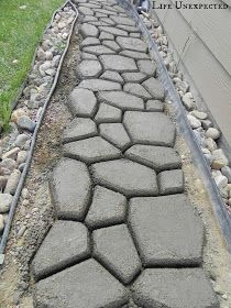 DIY Stepping Stone Pathway. Find stone stencil then fill with concrete
