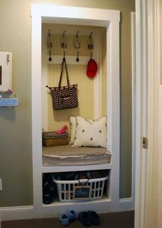 Mud room in a closet. Must do this Soon great place to drop backpacks, purse, coats and a catch all for the shoes. everything in one place no more running around in the morning.