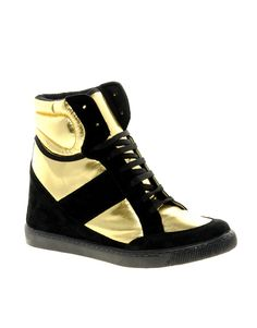 Going crazy for these metallic wedge high top sneakers