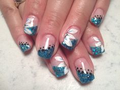 Teal slanted French with poka dot boarder and accent nails with white hand drawn flowers