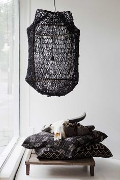 Pamela Makin of Les Interieurs does it so simply and so well. (Birdcage lamp inspiration)