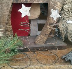 Our cool little Christmas trees made from a bedspring and a wood star!