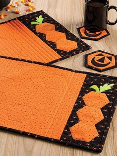 Created by the trusted editorial team at Quilter's World magazine, Simply Autumn is a bountiful collection of 25 projects to bring the warm tones and vibrant colors of fall into your home. Patterns for bed quilts, lap quilts, table runners, wall . Halloween Sewing, Fall Sewing, Halloween Quilts, Halloween Placemats, Quilting Tutorials, Quilting Projects, Quilting Designs, Table Runner And Placemats, Quilted Table Runners
