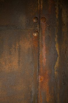 Sheetrock wall, upholstery nails, and cardboard painted with brutal rust iron reactive paint. www.brutalrust.com