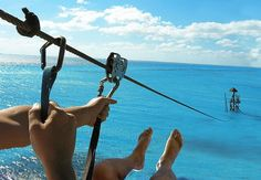 Zip-lining into the ocean!!!  Umm yes! I have no idea where this is but totally ok