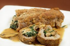 Pork Tenderloin stuffed with sausage and spinach, served with a Mushroom Marsala Sauce