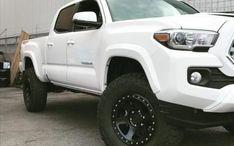 2017 Toyota Tacoma Toytec BOSS Leveling kit, Method Wheels, LEER Canopy at Dales Auto Service