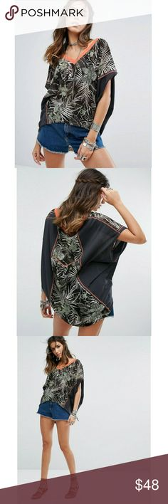"""We The Free Margot T-shirt Totally Chic leaf print t-shirt! Features V-neck pullover style with high low hem. Perfect for that getaway vacay,casual wear or swim cover-up! NWT!  Size M approx measurement laying flat Bust 30"""" Length front 23"""" back 27.5"""" (loose fit shirt) Free People Tops Tees - Short Sleeve"""