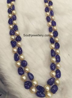 Two Layer simple yet trendy beads necklace, 22 carat gold intricate blue sapphire beads and south sea pearls combination feast for the ey. Indian Jewellery Design, Bead Jewellery, Indian Jewelry, Jewelry Necklaces, Designer Jewellery, Jewellery Shops, Tanishq Jewellery, Temple Jewellery, Pearl Necklace Designs