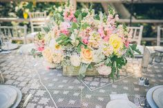 Dahlias, roses, snapdragons, dusty miller and lamb's ear made up the ...