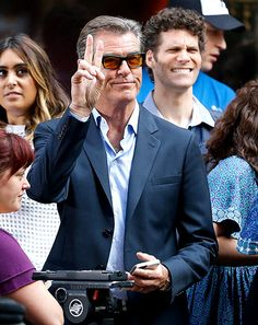 "Pierce Brosnan, rockin' sunnies with orange tinted lenses, flashed the peace sign to fans during the ""Today"" show!"