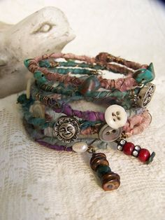 Set of 6 handmade bracelets, each decoratively wrapped with silk , wire, dangling charms, dozens of beads, gemstones, crystals, rhinestones, vintage