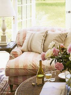 pink and white striped sofa on the patio would be lovely.