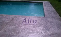 Stamped concrete pool deck overlay in seamless stone.