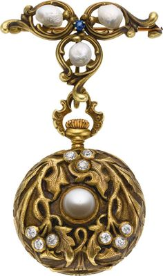 Swiss Art Nouveau Gold, Diamond & Pearl Pendant Watch, circa 1905 Case: 14k green gold with raise Art Nouveau vines, central 7 mm half pearl, nine bezel set diamonds, .50 cttw., 28 mm, inner gold dust cover, matching 14k pin set with three Baroque pearls and a small sapphire
