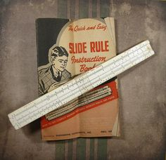 Vintage Engineering Instruments 250-BT slide rule, circa 1960's, including the 28 page manual. The front of the rule is printed on painted wood and it has a standard plastic cursor (not magnified).