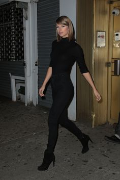 Taylor leaving MSR Studios in New York City on October 7, 2015 wearing an Aritzia sweater, Urban Outfitters jeans, and Prada booties.