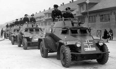A column of SdKfz 223 light armored cars parade through a major city street in Army Vehicles, Armored Vehicles, Mg 34, Luftwaffe, Hors Route, Armoured Personnel Carrier, Afrika Korps, Ww2 Photos, Armored Fighting Vehicle