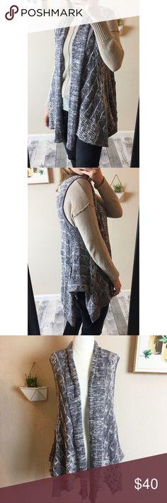 """Anthropologie Moth Lavena Sweater Vest Duster Anthropologie Moth """"Lavena"""" open, draped knit sweater vest in gray. Colors are gray and off white. Size M/L (can also work as an oversized small). Soft cotton / viscose blend. In very good preowned condition. No stains, holes, or significant wear. Anthropologie Sweaters Shrugs & Ponchos"""