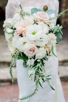 beautiful cascading wedding bouquets with greenery