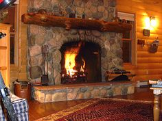 cozy fireplace | ... builder hand-picked the Arkansas River stones for this cozy fireplace