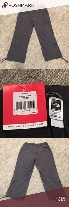 Brand new North Face Meridian Cargo Capree pants Brand new North Face Meridian Cargo Capree pants. Color is asphalt grey. Inside has additional straps for tightening skin waistband. Pockets on both sides of legs for storage. Adjustable straps on bottom of legs for additional tightening as well. Willing to sell both North Face Pants together just comment and offer a price! PRICE NOT FIXED, OPEN FOR NEGOTIATION- just make offer. North Face Pants