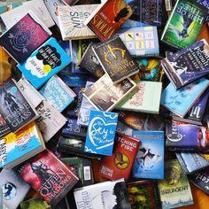 book pile by alittlebookworld