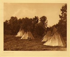 """Assiniboin camp, 1908. Photogravure. Curtis Caption: """"In making their camps the Indians often chose more picturesque spots."""""""