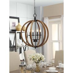 Rustic enough to please a Norse god while remaining perfect for the modernist with it's clean, open design, this chandelier's distressed wooden sphere is complemented by metal hardware.