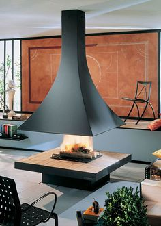 15 gorgeous freestanding suspended fireplace design ideas for Central fireplace