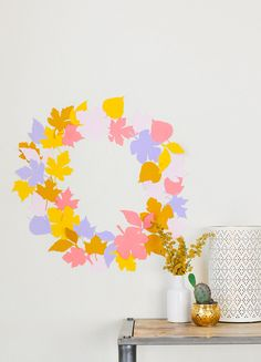 This do-it-yourself paper leaf wreath is such a simple and chic way to add a splash of color to the living décor.