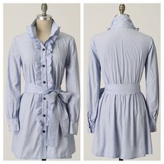 Anthropologie blue button down tunic Anthropologie blue button down tunic. Ruffle detailing. Size medium. This shirt has been worn. I can't find any flaws. Good condition. Anthropologie Tops Button Down Shirts