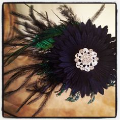 Black Magic by Blooming Things on etsy- hair flower and brooch $20