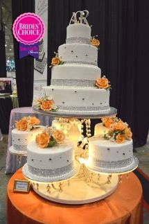 1ST PLACE: Elegant white, silver and oranges wedding cake from Reeves Cake Shop at the 2015 I-X Center Cleveland bridal show | As seen on TodaysBride.com