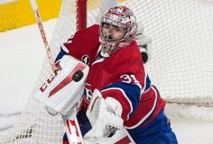 Montreal Canadiens goalie Carey Price deflects a Tampa Bay Lightning shot during the first period of Game 5 of a second-round NHL Stanley Cup hockey playoff series Saturday, May 9, 2015, in Montreal. (Paul Chiasson/The Canadian Press via AP)
