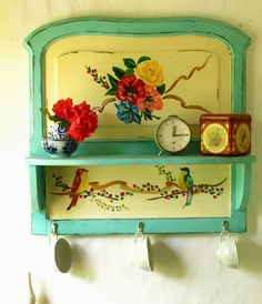 E c ℓ e c t i c . I n t e r i o r s, it looks like a panel from an old mirror or from furniture, pop a shelf on it and paint, very cute :)