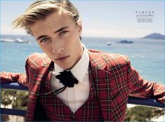 Lucky Blue Smith is front and center in a red tartan suit from Gucci.