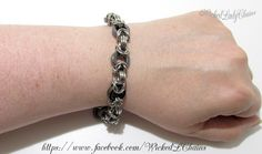 Chunky Byzantine Chainmaille bracelet in Stainless Steel. Black Hematite donut beads. Stainless Steel Lobster clasp and extension chain. Completed with Celtic Knot charm.