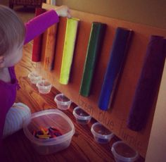 A good colour game for teaching 1 1/2 to 2 1/2 years old toddlers ... You need different colour caryon and a empty kitchen roll coloured in the main easy colours...