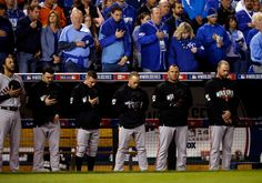 San Francisco Giants players take part in a moment of silence for St. Louis Cardinals player Oscar Taveras, who was killed in an auto accident this week in the Dominican Republic,  before Game 6 of baseball's World Series against the Kansas City Royals at Kauffman Stadium in Kansas City, Mo., on Tuesday, Oct. 28, 2014. (Nhat V. Meyer/Bay Area News Group)