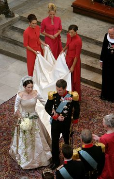 Danish Crown Prince Frederik walks down the isle next to his new bride Princess Mary after they marry in Copenhagen Cathedral May 14, 2004 i...