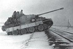 Panzerkampfwagen of Panzer regiment Bake in winter. Notice the improvised footsteps in the…