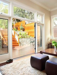 glass doors with transom windows, making it the brightest room in the home. The doors can be folded back Bright Rooms, Transom Windows, Interior Barn Doors, Patio Doors, Victorian Homes, Home Renovation, French Doors, Family Room, Sweet Home