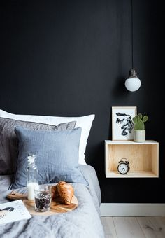 Black and masculine bedroom with bed table in wood. Side table for bedroom Bedroom Black, Small Room Bedroom, Bedroom Lamps, Home Bedroom, Bedroom Furniture, Bedroom Decor, Bedroom Lighting, Bedroom Chandeliers, Wall Lamps