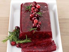 This cranberry sauce has pieces of apple, which are loaded with pectin, a natural gelling agent. The apple pectin firms up the sauce so it's sliceable.