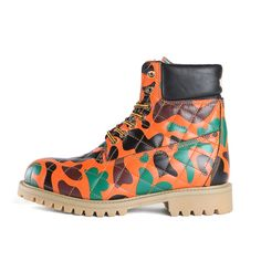 The Moschino Camo Print Boots are a camouflage print quilted leather ankle boot. They feature reinforced eyelets, metal logo lettering on collar and treaded rubber sole. - Materials: 90% Calf Leather