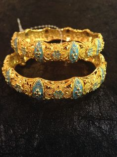 Gold and enamel bangles from Erbil's gold market